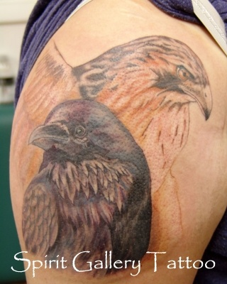 Raven and Red Tailed Hawk tattoo on upper arm. Love me some ravens! Artist Blaze Schwaller