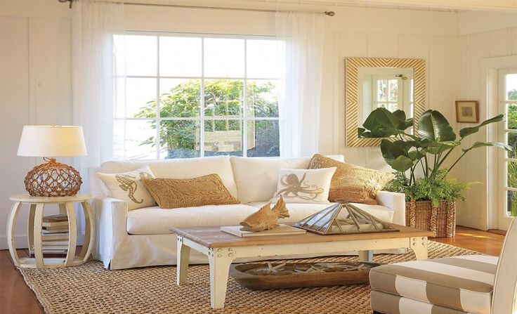 Living Room, Rattan Area Rug White Fabric Loveseat Unique End Table Modern Table Lamp Long Wooden Coffee Table Rattan Basket With Corner Plant White Transparent Glass Window Transparent Sliding Curtain: Appealing Beach Cottage Decoration - Nautical Living Room Design Concept