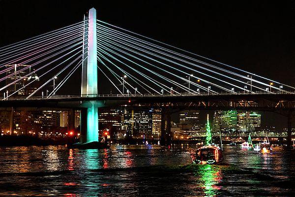 Christmas Ships Portland Oregon 2020 The Christmas ships of Portland, Oregon pass under the Tilikum