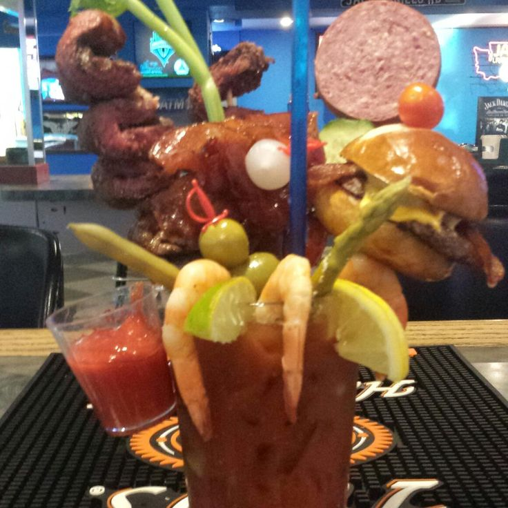 The Garage Bar and Grill,  Bremerton, WA.  Yes, that's a Bloody Mary with a cheeseburger slider and other amazing goodies on board.
