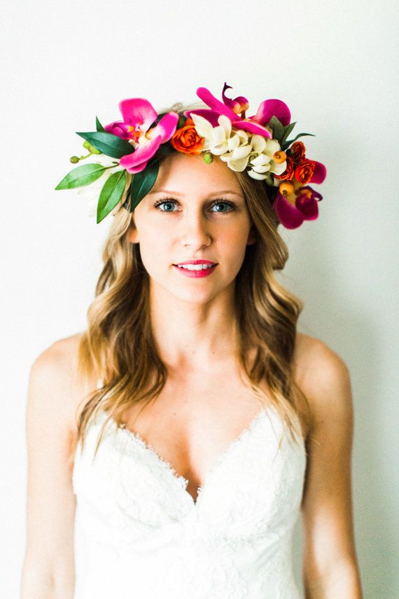 orchids, alpinia, ranunculus, + orange berries make up this colorful + tropical-inspired flower crown. perfect for beach destination