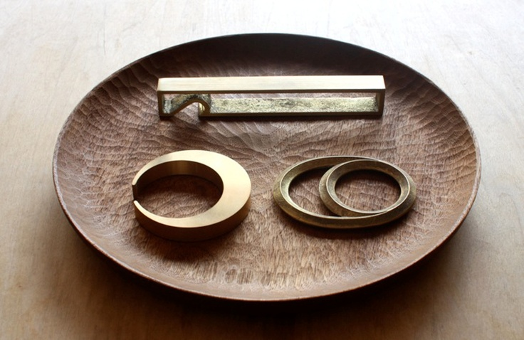 Beautifully minimal bottle openers by Japanese designer Masanori Oji, finely crafted from solid brass and now available at British online retailer Raw Dice...