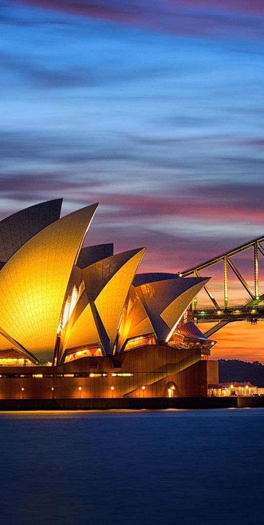 Sydney, Australia | No trip to Sydney, Australia would be complete without a stop at the Sydney Opera House. This building is one of the 20th century's most famous and distinctive buildings – and one that you could spend hours exploring. #honeymoon #Australia