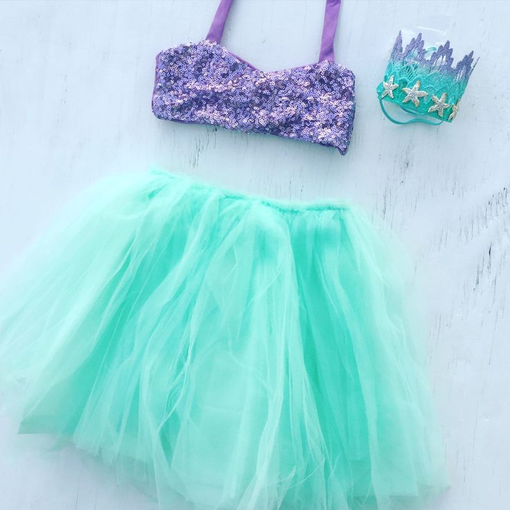 Our items are one of a kind heirloom pieces. This listing is for the Merbabe™ Sparkle crop top & tutu only. CROWN NOT INCLUDED The sequin top is a halter. The neck ties help you adjust to the desired