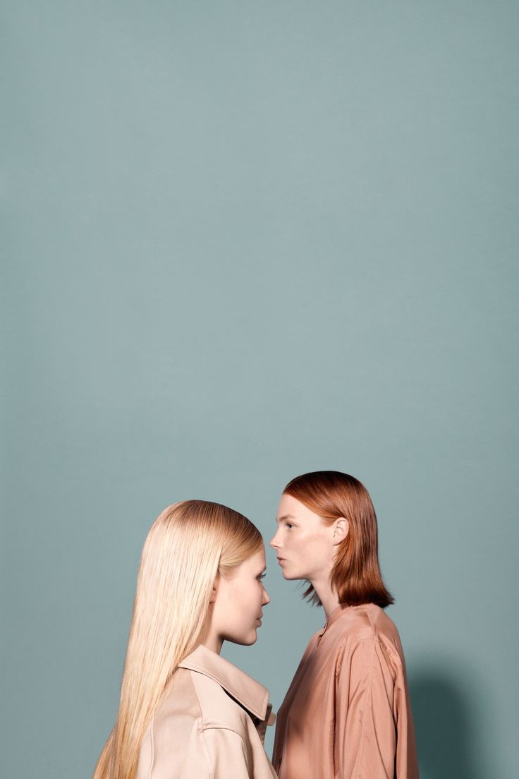 Two women, face to face, fashion editorial
