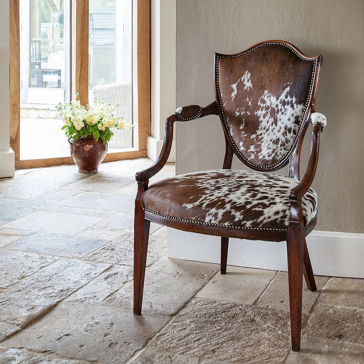 pair of antique cowhide chairs by katie bonas | notonthehighstreet.com
