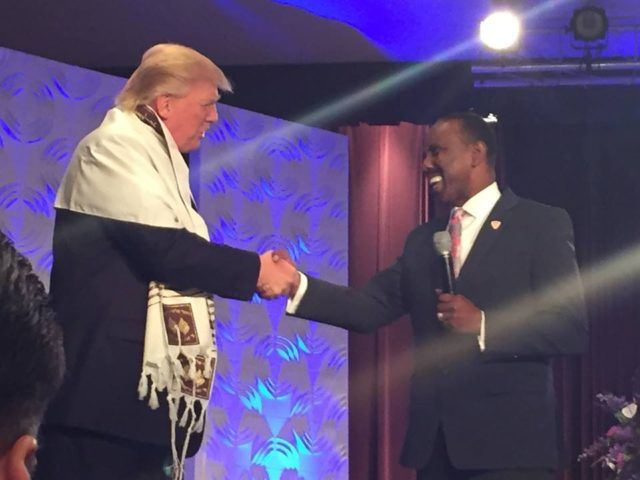 In Detroit, Black Pastors give Trump Jewish Prayer Shawl from Israel