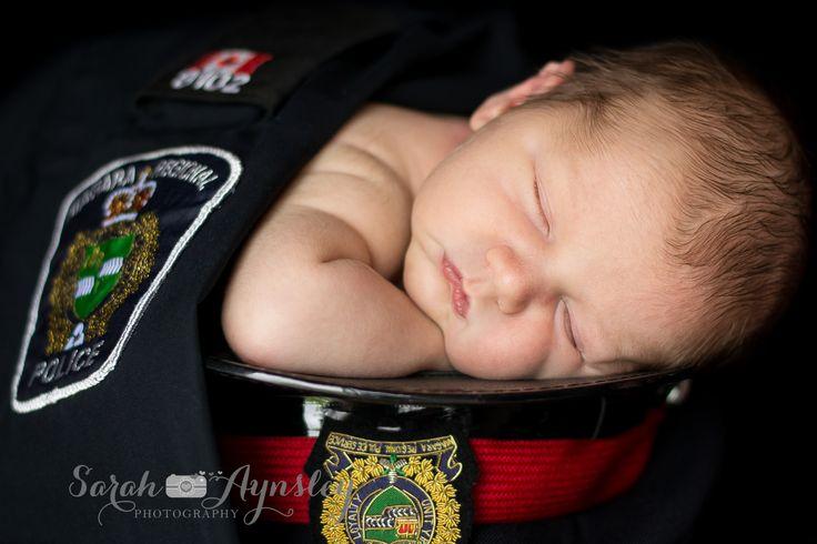 newborn in daddy's police uniform www.sarah-aynsleyphotography.com