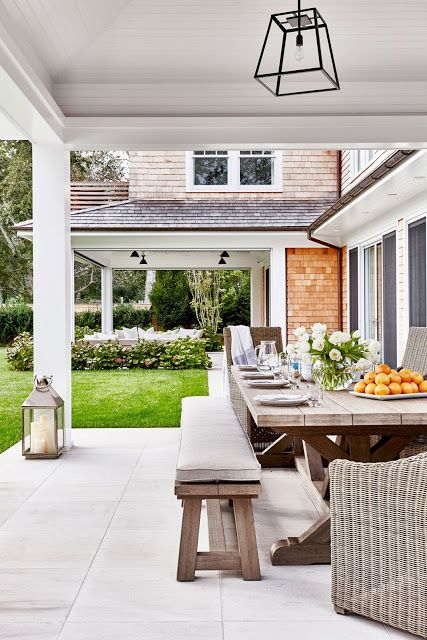 Love matt tiled floor. Love the two verandahs. One for dining and other for seating. Separated by grass. Great style.