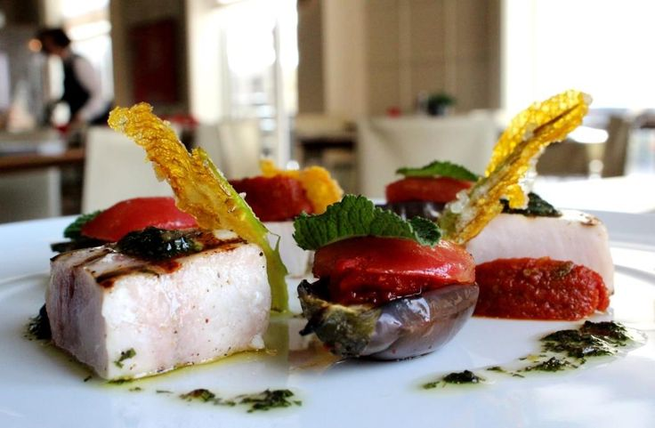 Grilled swordfish with grilled eggplant, dry tomatoes pesto, zucchini flower tempura and minted condiment
