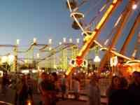 Carnival on Alameda Boulevard at Federal. Row forgiven, merry-go-rounds, Ferris wheels, popcorn, roulette wheels, sawdust and dust, Sad music. Motorcycle kids in back of the tents, Mexican girls, watch them but D says he couldn't talk to them.198