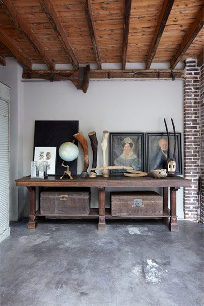 exposed brick, concrete floors, and wooden ceilings. This is a rare, and beautiful paris apartment!