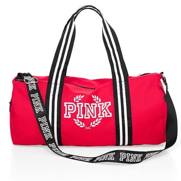 Victoria secret duffle bag BRAND NEW RES VS PINK DUFFLE BAG, PERFECT FOR THE GYM, THE BEACH, WEEKEND GATEWAY? OR JUST TO HAVE. HAS STRAPS FOR SHOULDER AND TO HOLD BY HAND WITH PINK LOGO ON THE STRAPS PINK Victoria's Secret Bags Shoulder Bags