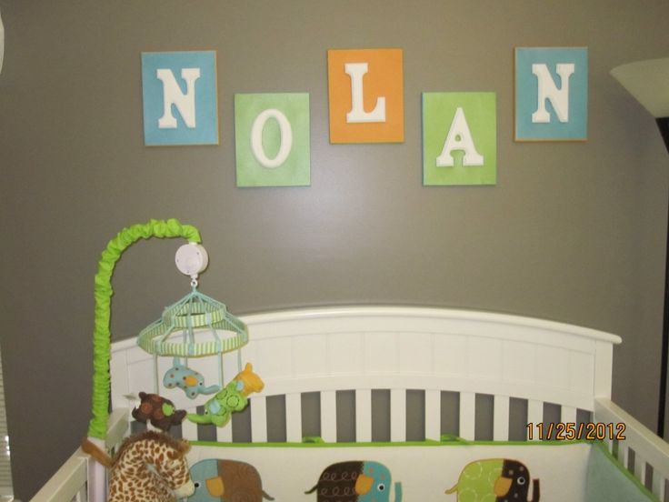 Wooden letters on canvas for above Baby's crib. Love this idea!