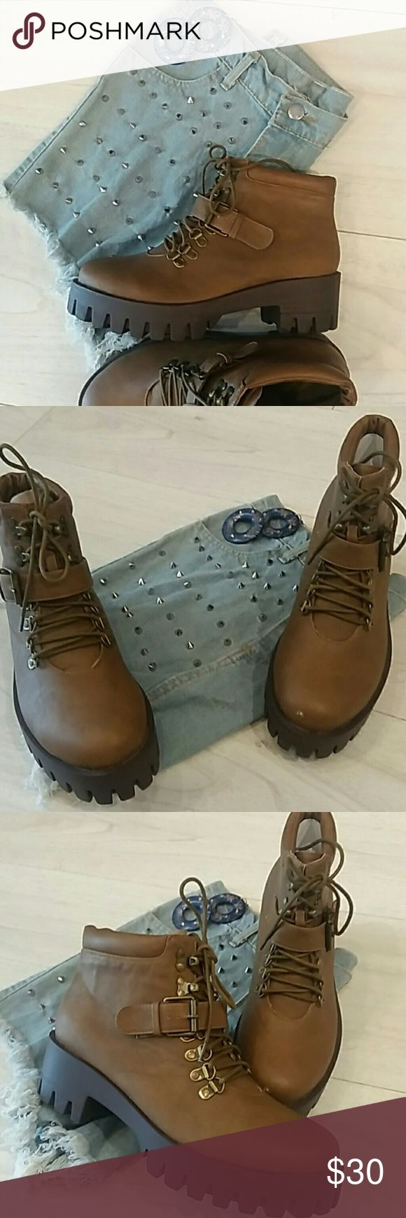 LAST PAIR Timberland Style Great for daily walking, site-seeing and even light hiking/camping. Eurotrip ready! Very stylish with jean shorts or sporty attire.  Style similar to Timberlands or Dr. Martens  Man-made materials and synthetic sole. Priced for a quick sale Shoes