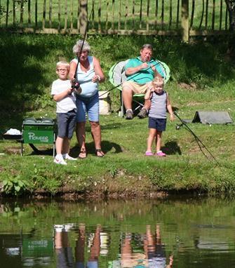 Family enjoying their fishing holiday at Meadow Lakes