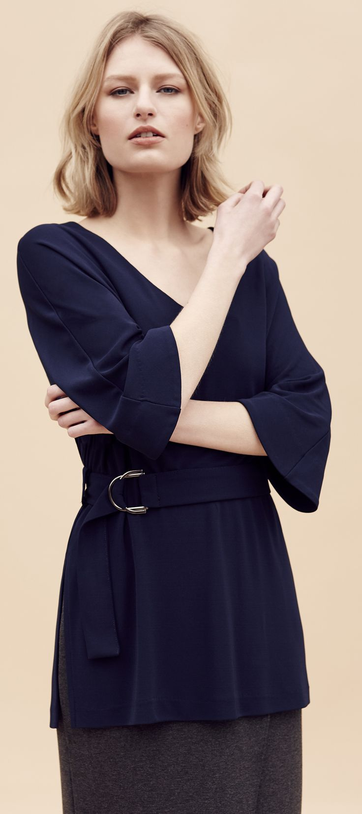 This stunning blue 3/4 Sleeve Crêpe Belted Tunic works in the office and for an evening out.