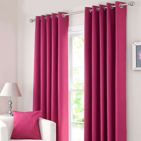 Crafted with a minimalist design in a bold shade of pink, our ready made eyelet curtains feature blackout lining to significantly reduce external light entering...