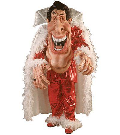 Showman kostuum deluxe. Dit extravagante en prachtige showmaster kostuum bestaat uit de jas, broek, gevederde cape met hoge kraag, schoudervullingen en oversized masker en handen. Super deluxe showman kostuum. One size, fits all.