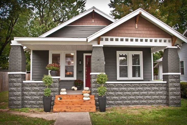 Architecture Craftsman Style Home Exteriors Four White Window Along Gray Door Brown Brick Front