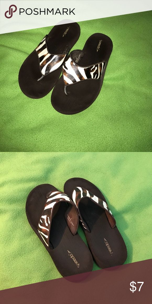 Brown zebra stripe flip flops. Cute flip flops with a lot of cushion and tread. EUC. Speedo Shoes Sandals