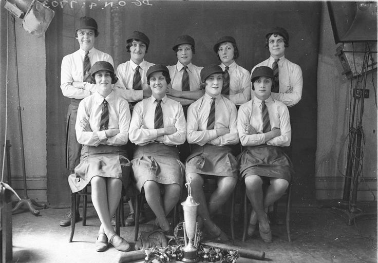 A studio group photo of nine women's baseball players with their trophies and gear. Taken by Sam Hood in the 1930's. From the Mitchell Library, State Library of New South Wales : http://www.acmssearch.sl.nsw.gov.au/search/itemDetailPaged.cgi?itemID=8748