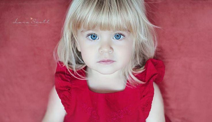 Little girl in red www.larascott.co.za