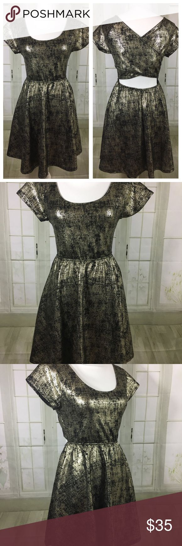"""NWOT Rolla Coaster gold metallic party dress Sz M New without tags!  Pullover, lightweight, frabric gives additional stretch. Back cut out design.   Approx. Measurements laying flat:  Underarm to underarm: 16""""  Waist: 12 1/2"""" - Stretches  Length: 33""""   Questions please ask!   Bin#2 rolla coaster Dresses Mini"""