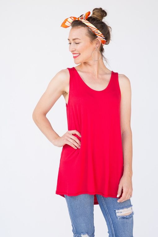 Tunic length1 ¼ inch thick strapsRayon Spandex Easy fit through the midsection/waistThe beauty of this tank is in its name — it's essential. As a staple piece in any closet, this flowy favorite can easily be worn alone, or paired with one of A&D's Essential Cardigans. With so many color and pattern options, owning just one of these tanks may be near impossible. As a revamped model of our classic Basic Tank, this top expands your wardrobe and keeps you cool, all summer long. W...
