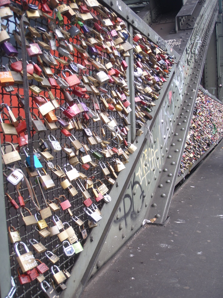 Bridge covered in locks. Lovers are supposed to stand on the bridge, lock the lock together and throw the key into the river! Colonge, Germany! Photo by Lauren Podstupka