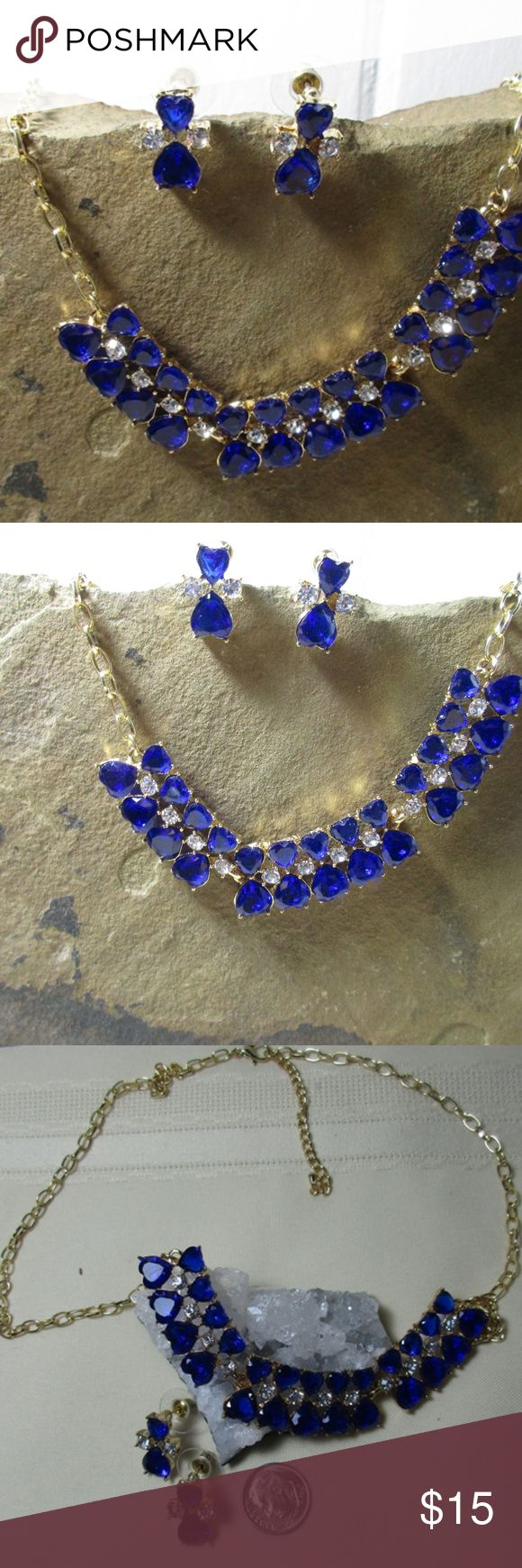 Blue CZ double heart necklace & earrings set Blue CZ double heart necklace & earrings set , 18 inch chain with 2 inch extender, yellow gold plated. The hearts are 1 inch from top to bottom and comes with cute matching earrings. This is just a fun set.  See it's smiling at you. Jewelry Necklaces