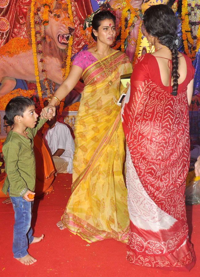 Kajol in conversation with cousin Sharbani. Also in picture: Yug at a Durga Puja pandal in Mumbai. #Bollywood #Fashion #Style #Beauty