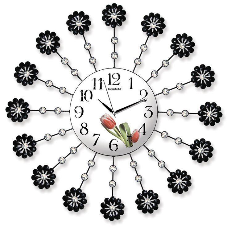 Taşlı Ferforje Dekoratif  Duvar Saati  Ürün Bilgisi ;  Ürün maddesi : Metal gövde, gerçek cam Ebat : 62 cm  Mekanizması : Akar saniye, sessiz çalışır Garanti : Saat motoru 5 yıl garantili Taşlı Ferforje Dekoratif  Duvar Saati Üretim  : Yerli üretim Kullanım ömrü uzundur Kalem pil ile çalışmakta Ürün fotoğrafta görüldüğü gibi olup orjinal paketindedir Sevdiklerinize hediye olarak gönderebilirsiniz