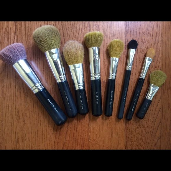 "Bare Minerals Brush Set All natural hair brushes except for ""buffing eye"" which is synthetic. Less than half the retail for these brushes! The handle on the ""heavenly face"" is cracked but works perfectly otherwise, and some of the bristles have come out of the ""flawless face"" brush. Price is reflective of defects. All brushes have been cleaned and sanitized. Smoke free/pet free home. No returns. Price includes shipping and PP. Also willing to trade for other HE brushes/makeup (non-bare…"