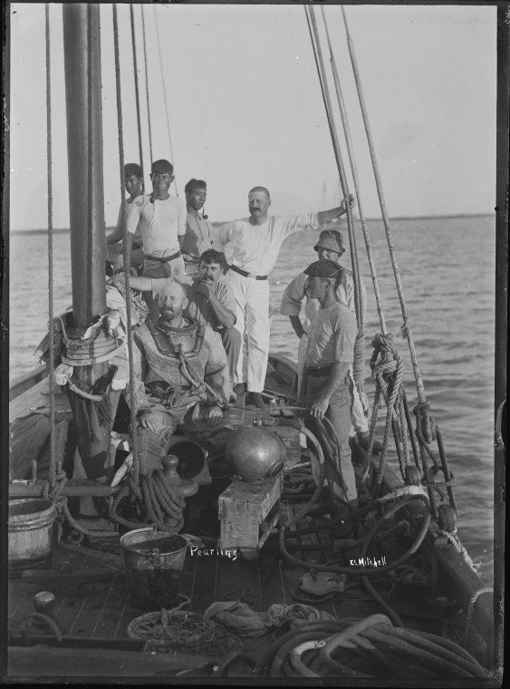 008693PD: Jackie Pryor (wearing peaked cap) and Reg Archer (wearing whites) with a pearl diver and crew, Broome, ca. 1910  https://encore.slwa.wa.gov.au/iii/encore/record/C__Rb2944239