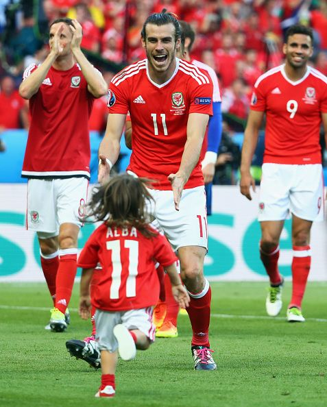 #EURO2016 Gareth Bale of Wales celebrates his team's win with his daughter Alba Violet after the UEFA EURO 2016 round of 16 match between Wales and Northern...
