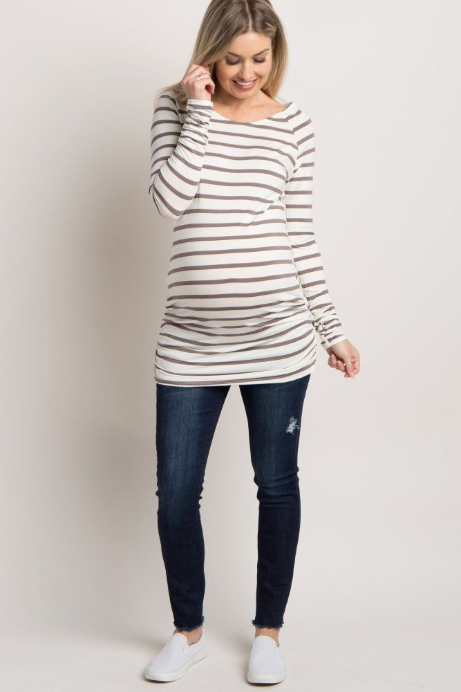A striped maternity tunic. Rounded neckline. Ruched sides. Long sleeves with ruched cuffs.