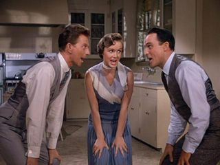 """Kathy Selden (Debbie Reynolds): """"Oh, no offense. Movies are entertaining enough for the masses but the personalities on the screen just don't impress me. I mean they don't talk, they don't act, they just make a lot of dumb show. Well, you know."""" -- from Singin' in the Rain (1952) directed by Stanley Donen and Gene Kelly"""