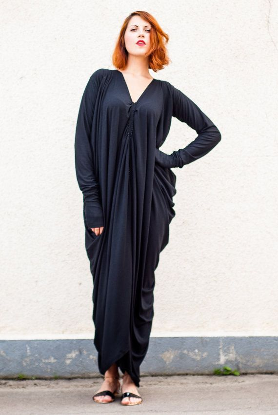 Black plus size dress folded in middle front. Oversize maxi dress
