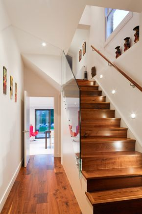 Granit Chartered Architects - gorgeous hallway with rich wood floor and staircase beautifully balancing the contemporary walls and glass panels. The spot lighting up the side of the staircase and minimal use of accessories finish the scheme off wonderfully.