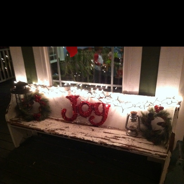 Old church bench decorated for Christmas