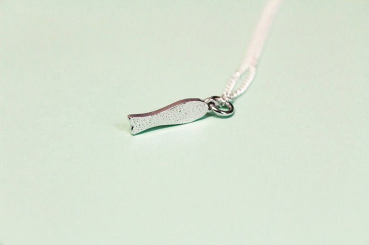 Chocolate Fish sterling silver pendant by FrankieAndCoNZ on Etsy