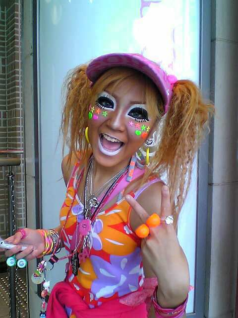 Ganguro (ガングロ) is an alternative fashion trend of blonde or orange hair and tanned skin among young Japanese women that peaked in popularity around the year 2000, but remains evident today. The Shibuya and Ikebukuro districts of Tokyo are the centre of ganguro fashion. Ganguro appeared as a new fashion style in Japan in the early 1990s and is prevalent mostly among young women and women in their early 20s to this date. In ganguro fashion, a deep tan is combined with hair dyed in shades of...