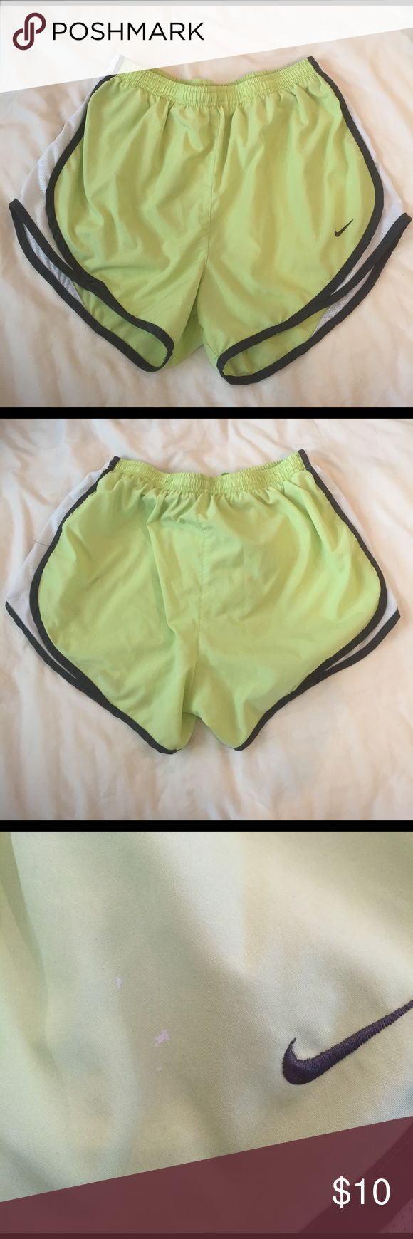 Nike dri fit shorts Light green/yellow Nike shorts. Inner lining has been cut out and there is a small white paint marking by the Nike symbol (shown) Nike Shorts