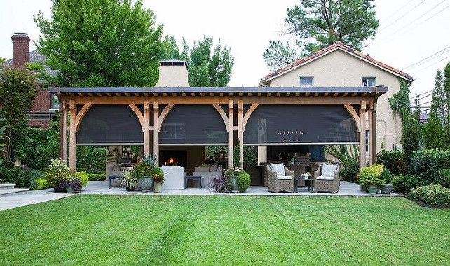 Backyard ideas. Outdoor area backyard ideas.  Covered patio features a living space and dining space finished with sliding mosquito screens. #Backyard  Austin Bean Design Studio.
