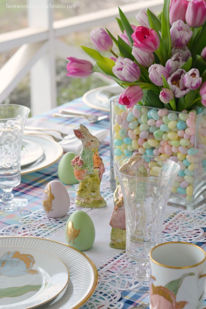 Easter table with bunnies, eggs, and tulips in jelly bean vase centerpiece!   homeiswheretheboatis.net