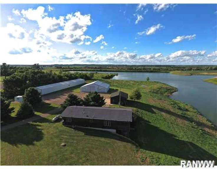 Here is your chance to own your own private lake with acreage! Ranch style home with walkout basement,3 season room overlooking lake,private master bath and new kitchen flooring. Exterior offers a 3 car detached garage,new roof, 50 x 56 shop with car hoist and a 30 x 180 pole shed for storage. Endless possibilities for hobby farm, car repair or fish hatchery. Lake boasts phenomenal fishing!