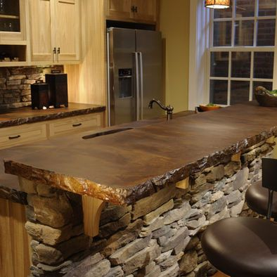Stained Concrete countertop! so rustic, love color. Link shows some fabulous stained concrete floors too.-Also love the rock on the 1/2 wall