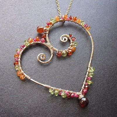 Hammered heart wrapped with gemstones