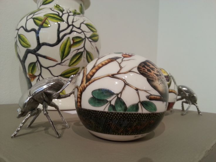 A beautiful hand painted ceramic ball and pewter beetle